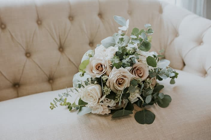 Blush and ivory bridal bouquet designed with roses, ranunculus, astrantia, astilbe and a mixed variety of eucalyptus