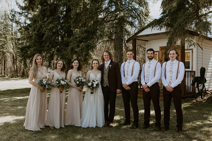 Rustic Elegance Bridal Party; bridesmaids wearing blush, groomsmen wearing suspenders; bouquets designed with blush, white & burgundy flowers