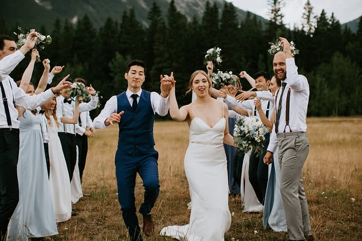 Bride and groom dancing with white and blue bridal bouquet