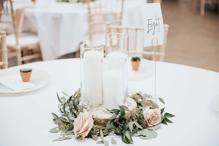 wedding centerpiece with eucalyptus and roses