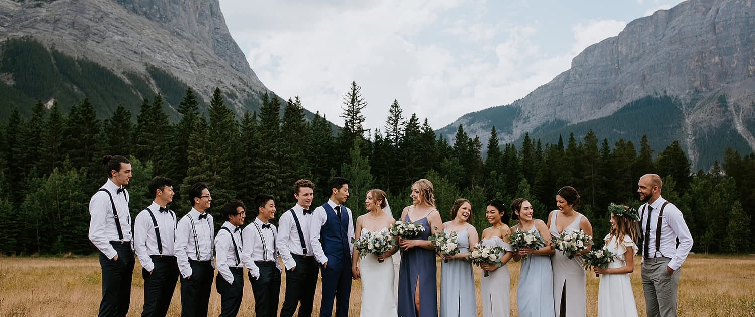White and blue Canmore Wedding bridal party with bridal bouquet, bridesmaids bouquets, boutonnieres designed with white and blue flowers