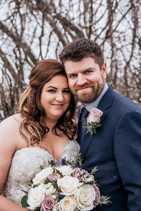 Mauve and Navy wedding, Erin and Nick with bouquet and boutonniere