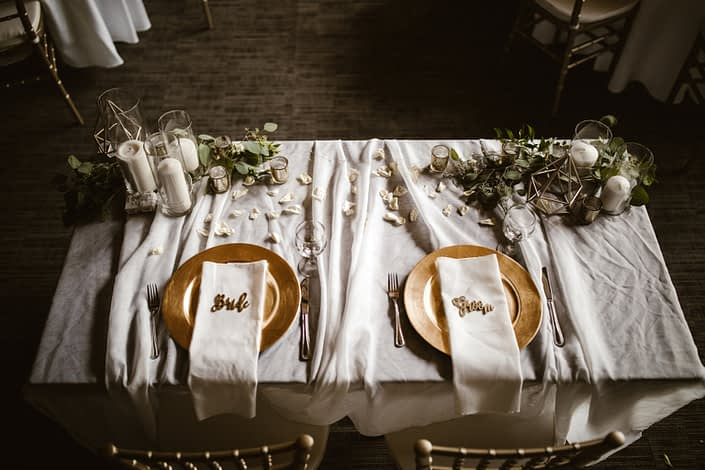 Bride and groom's sweetheart tablescape with accents of gold.