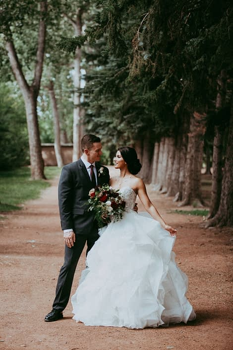 Bride and Groom; Cinderella gown and grey suit; burgundy and dark grey wedding; bridal bouquet designed with hearts garden roses, burgundy dahlias, amnesia roses and black pearl lisianthus