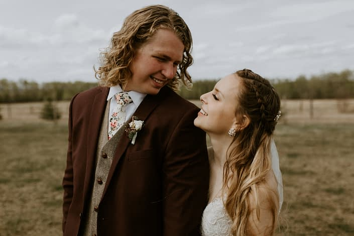 Rustic Elegance bride and groom, Emily and Jacob with spray rose boutonniere