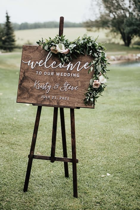 WEdding Ceremony sign with floral garland