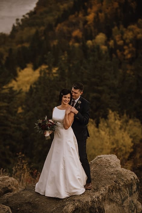 bride and groom at Canyon Ski Resort with burgundy and navy bridal bouquet