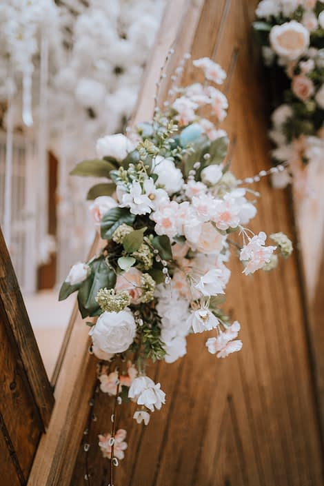 Pastel easter coloured flowers on the wooden backdrop for the Bower Place Easter 2021 display
