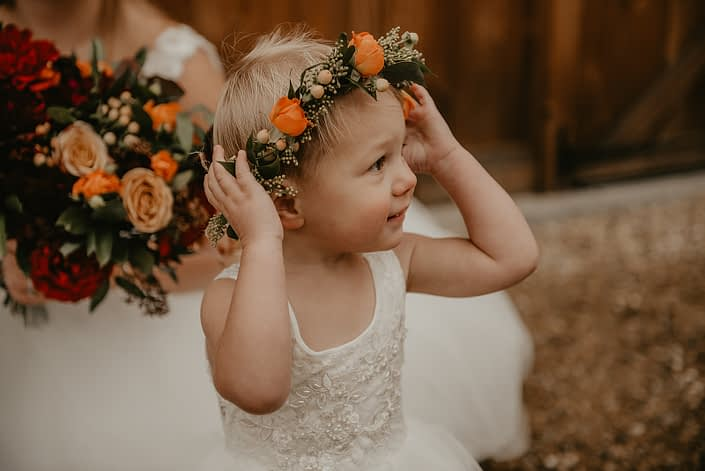 Flowergirl floral crown designed as a small delicate tie back floral crown with a mix of fall coloured blooms including solidago, hypericum berries and orange spray roses.